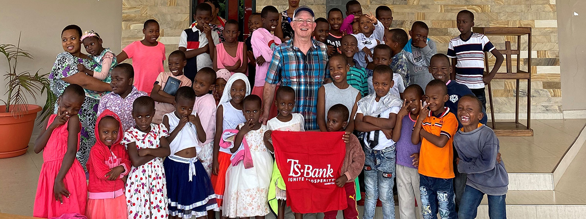 Kim Gibson pictured with the TS Bank flag at the chapel