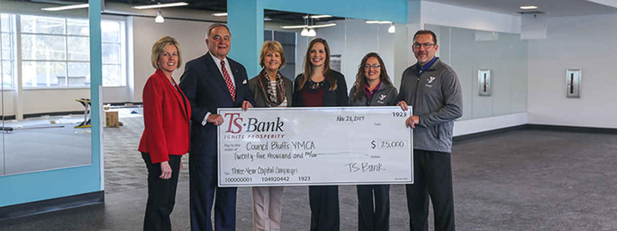 ts bank employees deliver check to ymca employees