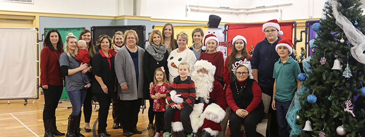 ts bank employees pose with santa at childrens square