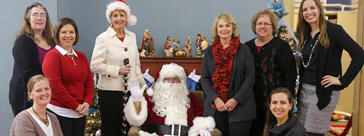 ts bank employees pose with santa claus at childrens sq