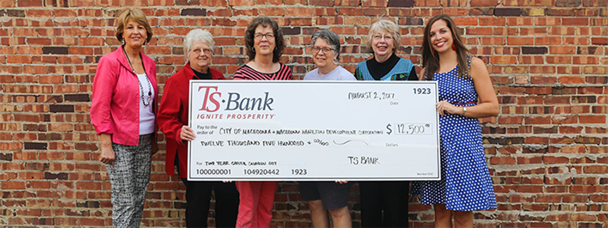 ts bank employees deliver check to city of macedonia em