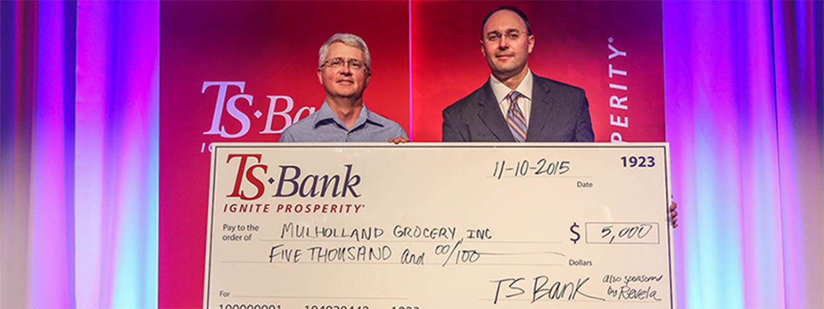 ts bank's josh guttau presents check for $5,000 to mulh
