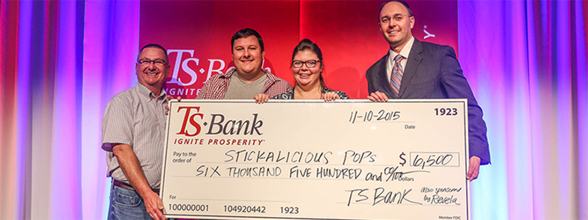 ts bank's josh guttua presents check for $6500 to stick