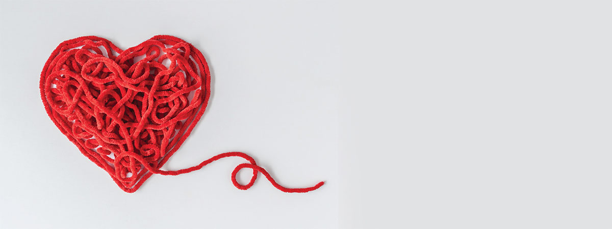 a red heart made of yarn