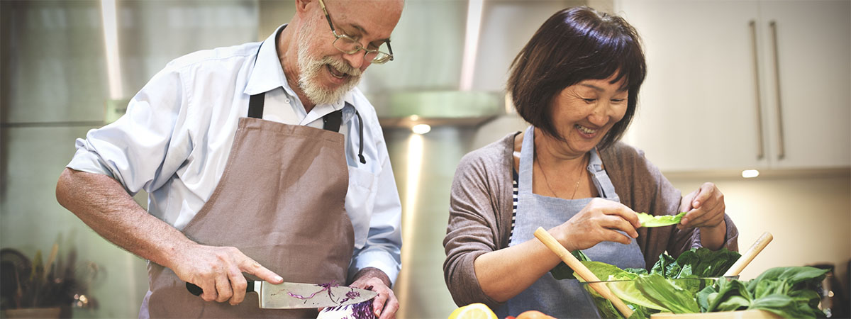 a couple taking a cooking class together