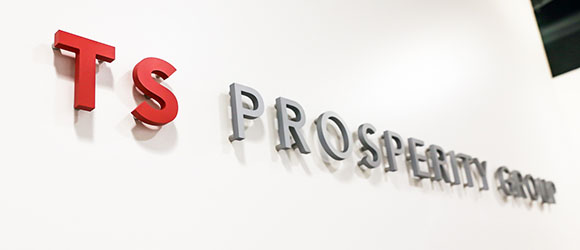 ts prosperity group logo on a wall in their office